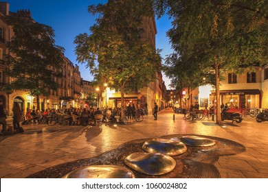 BORDEAUX, FRANCE - 19 January, 2017 : View of historical Porte Cailhau at night with full of people having dinner on restaurant terrace in Bordeaux, Gironde, Aquitaine, France