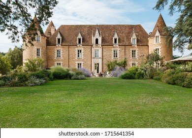 Bordeaux, France - 2019: Medieval french chateau surrounded beautiful garden and greenery. Old castle made from stones in France. Traditional architecture of bordeaux wine region. Summer landscape