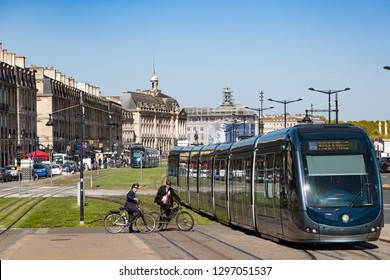 Bordeaux, France - 26th September, 2018: cyclists waiting for Electric Tram to pass on quai Richelieu in downtown Bordeaux.