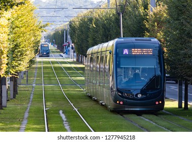 Bordeaux, France - 27th September, 2018: Modern public transport electric trams passing through tree lined streets in the city of Bordeaux.