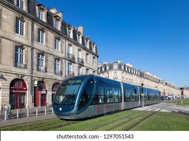Bordeaux, France - 27th September, 2018: Electric Tram passing through historic buildings on quai Richelieu in downtown Bordeaux.
