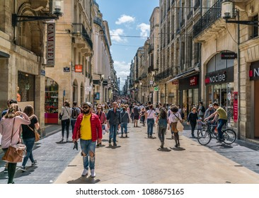 Bordeaux, France, 9 may 2018 - tourists and locals shopping in the main shopping street 'Rue Sainte-Catherine'