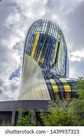 BORDEAUX, FRANCE - APRIL 14, 2019: La Cite du Vin (Wine Cultures and Civilisations Museum, 2016) - tourist attraction in Bordeaux, boasting cavernous exhibition halls and 55-metre-high viewing tower.