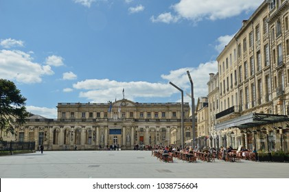 BORDEAUX, FRANCE - APRIL 25 2016: People relax in the outdoors restaurant in the square Pey-Berland of the French city Bordeaux. BORDEAUX, FRANCE - APRIL 25 2016.
