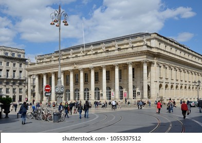 BORDEAUX, FRANCE - APRIL 25 2016: The many people walk and sit in the central square near the Grand Theatre. BORDEAUX, FRANCE - APRIL 25 2016.