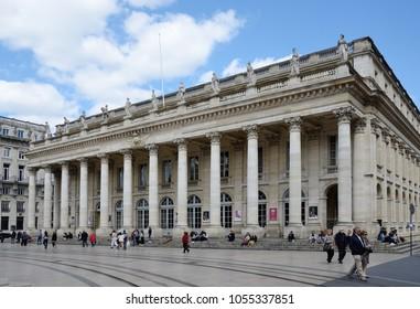 BORDEAUX, FRANCE - APRIL 25 2016: The people are near the Grand Theatre in the central square Place de la Comedie. BORDEAUX, FRANCE - APRIL 25 2016.