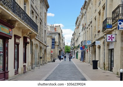 BORDEAUX, FRANCE - APRIL 25 2016: A pedestrian street with many shops and markets is filled with people. BORDEAUX, FRANCE - APRIL 25 2016.