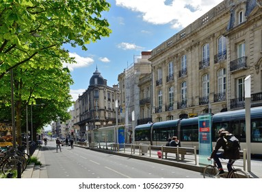 BORDEAUX, FRANCE - APRIL 25 2016: The cable-free tram runs in the modern street of the ancient French city. BORDEAUX, FRANCE - APRIL 25 2016.