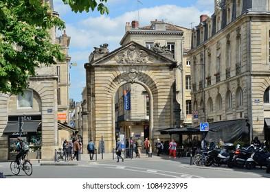 BORDEAUX, FRANCE - APRIL 25 2016: A concrete decorated arc in Bordeaux city. BORDEAUX, FRANCE - APRIL 25 2016.