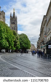BORDEAUX, FRANCE - APRIL 26 2016: The passers and a tram are in the street of the ancient French city Bordeaux. BORDEAUX, FRANCE - APRIL 26 2016.