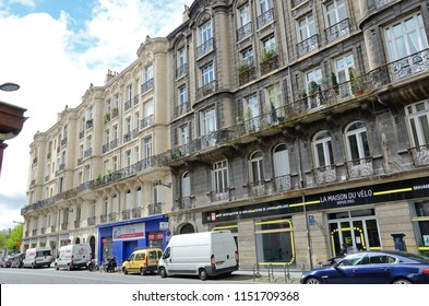 BORDEAUX, FRANCE - APRIL 26 2016: Cars are parked at the side of the ancient  street in the French city Bordeaux. BORDEAUX, FRANCE - APRIL 26 2016.