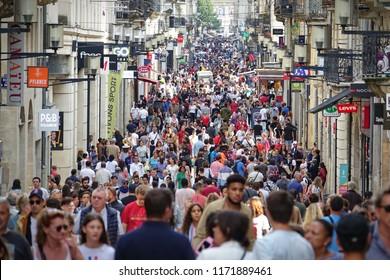BORDEAUX, FRANCE - august 2018: People walking in Rue Sainte Catherine, the main shopping street in Bordeaux.