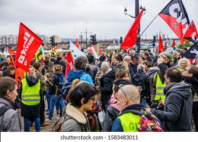 Bordeaux, France - December 7 2019 : Demonstration of C.N.T members, yellow vests and unions against the reforms of the pension system by the government of President Macron in the streets of Bordeaux