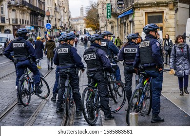 Bordeaux, France - December 7 2019 : Bicycle police patrolling during a demonstration of yellow vests and unions against the government of President Macron