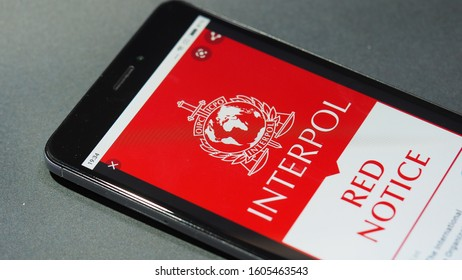 Bordeaux, France - January 04, 2020 : Interpol Red Notice displayed on mobile phone screen Top urgent procedure.