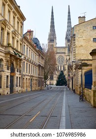 Bordeaux, France - January 1, 2017: Rue Vital Carles with Cathedral of St. Andre in background. Saint Andre is a gothic cathedral of Bordeaux, capital of Aquitaine. France.