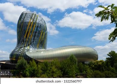 BORDEAUX, FRANCE - JULY 18, 2019: View of building of city wine museum of Cite du Vin with distinctive flowing shape