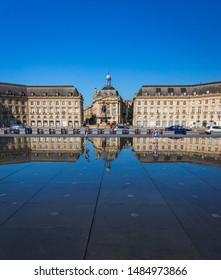 Bordeaux, France - July 2019 : Place de la Bourse and its world famous Miroir d'Eau (Water Mirror)