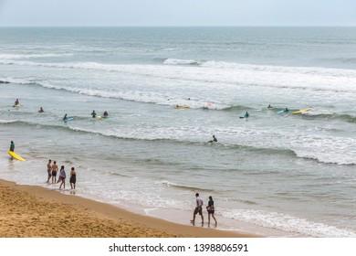 Bordeaux, France - June 13, 2017: Unidentified surfers enjoy waves in the water of Atlantic ocean on the coast near Lacanau-Ocean, Bordeaux, France