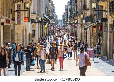 Bordeaux, France - June 14, 2017: People walk on Rue Sainte-Catherine in center of Bordeaux city. The Rue Sainte-Catherine, a 1.2 km long pedestrian street, is the main shopping street in Bordeaux