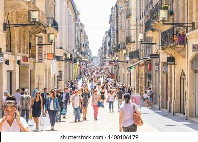 Bordeaux, France - June 14, 2017: People walk on Rue Sainte-Catherine in center of Bordeaux city. The Rue Sainte-Catherine, a 1.2 km long pedestrian street, is the main shopping street in Bordeaux