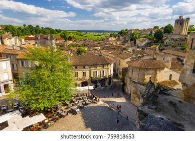 BORDEAUX, FRANCE - June 16, 2014: View of Saint Emilion downtown cityscape with cafes and tourists around where is famous with her vineyards in Bordeaux.