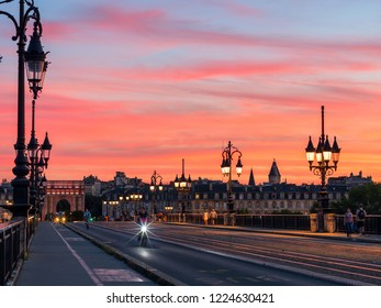BORDEAUX, FRANCE - JUNE 2018: Amazing cityscape of Bordeaux with pedestrians and cyclists moving by Stone Bridge and amazing sunset sky over the city, France.