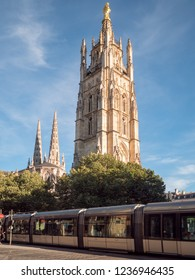 BORDEAUX, FRANCE - JUNE 2018: City tram passing by near the Pey Berland tower in the Bordeaux, France.