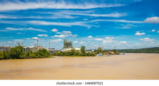 Bordeaux, France - June 2019: Cite du Vin Museum of wine in Bordeaux France, wide shot on a beautiful sunny day with a view of the Garonne River