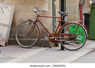 BORDEAUX, FRANCE â?? June 23, 2015: Bicycle chained to lamppost in the centre of the city whilst owner shops.