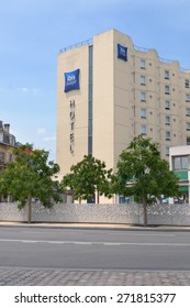 BORDEAUX, FRANCE - JUNE 27, 2013: Building of ibis budget hotel near the Saint Jean train station. The first ibis opened in Bordeaux in 1974, and now there is more than 1000 hotels in the world