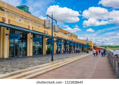 BORDEAUX, FRANCE, MAY 14, 2017: People are enjoying a sunny day on promenade alongisde Garonne river in Bordeaux, France