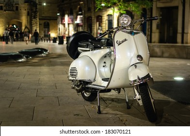 BORDEAUX, FRANCE - MAY 8, 2013: Old Vespa parked at night in Bordeaux city center.