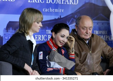 BORDEAUX, FRANCE - NOVEMBER 13, 2015 : Elizaveta TUKTAMYSHEVA  of Russia (C), her coaches Alexey MISHIN (R) and T. PROKOFIEVA (L) wait for marks after short program at Trophee Bompard ISU Grand Prix.
