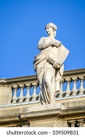 BORDEAUX, FRANCE, November 15, 2015: POLYMNIA statue, Muse of Sacred Poetry, the 5th of 12 statues on the top of the Grand Theatre of Bordeaux. Sculptor Pierre Francois Berruer (1733-1797).