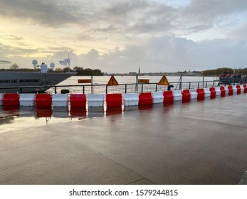 Bordeaux, France - November 2019 : barriers and warning signs blocking access to the Garonne docks during a flood in Bordeaux