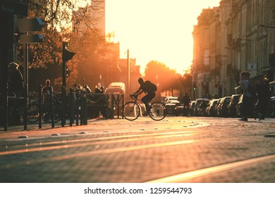 BORDEAUX, FRANCE- October 1, 2018 : City street scene, selective focus on people walking on street with tramway during the sunset in Bordeaux, France