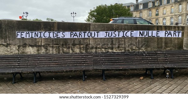 "Bordeaux, France - October 2019 :  Protest poster against domestic violence and femicide stuck on a wall in Bordeaux, France saying ""feminicides everywhere justice nowhere"""
