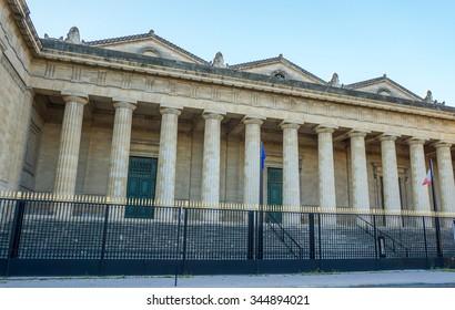 """Bordeaux, France, September 03, 2015 : Entrance of Bordeaux main courthouse """"Palais de Justice"""", situated Place de la Republique with twelve huge columns."""