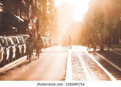 BORDEAUX, FRANCE- September 17, 2018 : Street photography, selective focus on the couple riding bicycles during the sunset in Bordeaux city, France. Vintage style