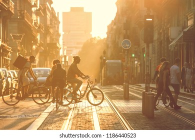 BORDEAUX, FRANCE- September 17, 2018 : Street photography, people crossing the road during the sunset in Bordeaux city, France. Vintage style