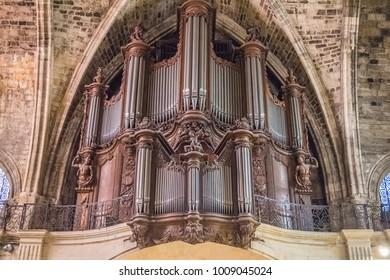 BORDEAUX, FRANCE, SEPTEMBER, 2015: Interior of Saint Seurin Basilica, Bordeaux, France, UNESCO - the Pilgrim's Road to Santiago de Compostela. close up of pipe organ