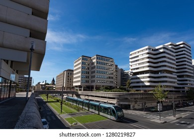 BORDEAUX, FRANCE- September 22rd, 2018: Tram passing through the modernist architecture of the Mériadeck district in the city of Bordeaux.