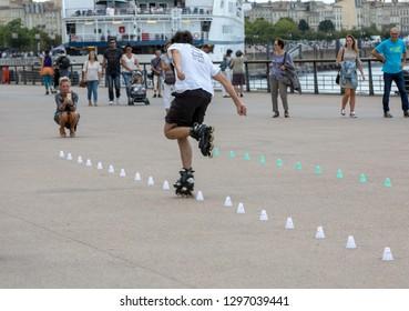 Bordeaux, France - September 9, 2018: Roller skater performs acrobatics in Quai Lousi XVIII in Bordeaux, France