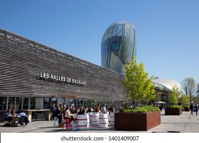 Bordeaux Nouvelle Aquitaine / France - 03 28 2019 : halles de Bacalan Bordeaux with cite du vin background