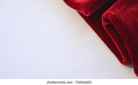 Bordeaux velvet on a light gray background, frame on the side, background, congratulation,mocked up,selective focus.