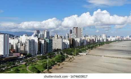 Border of the beach of the cities of Santos with São Vicente, Brazil. Location called Submarine Emissary. Beautiful monument made by the architect Oscar Niemeyer.