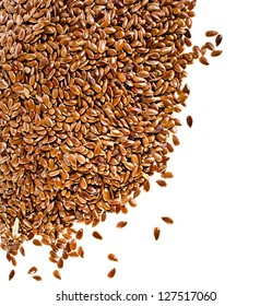 border of brown flax seed linseed closeup isolated on white background