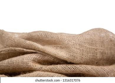 Border of burlap or jute open woven fabric on white background.