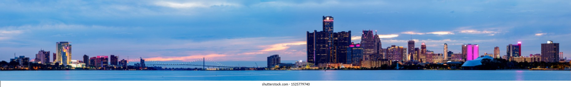 The Border Cities of Detroit, Michigan, United States of America, and Windsor, Ontario Province, Canada, connected by the Ambassador Bridge as seen from the Detroit River at Sunset